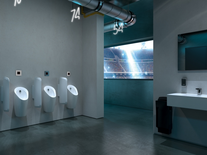 Bathroom Urinal Preda with concealed control by Geberit.