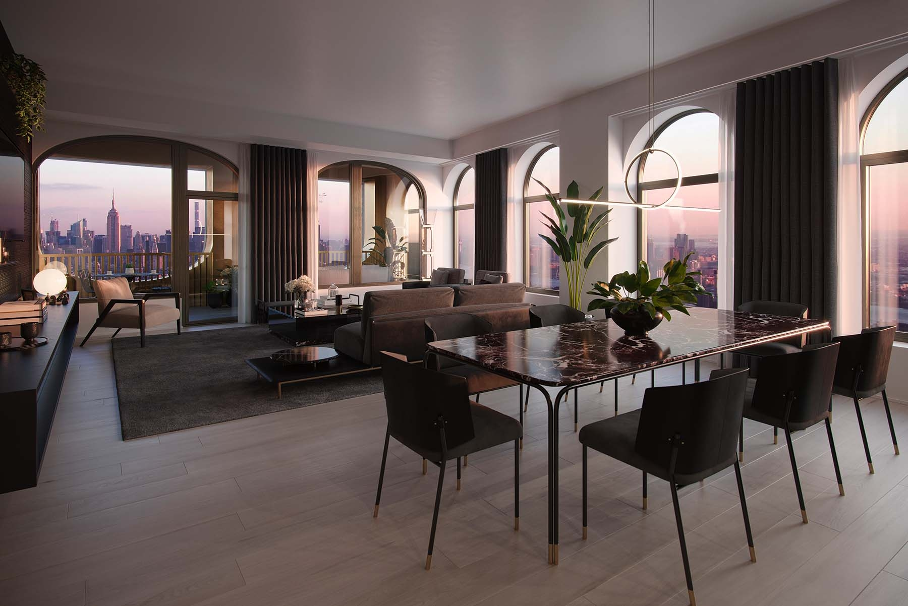 El comedor y la sala de estar cuentan con muebles de la colección Aston Martin Home de Formitalia.